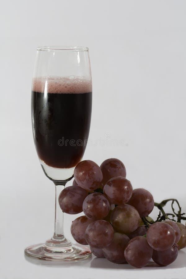 стеклянное вино виноградин стоковое фото
