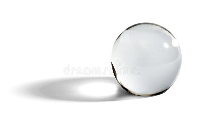 Стеклянный шарик или шар с тенью стоковое изображение