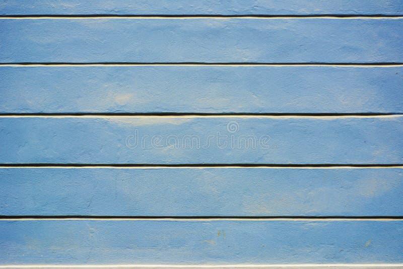Стена - голубая текстура предпосылки покрытия краски стоковое изображение