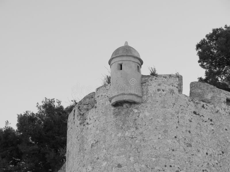 Стена и небольшая башня Castillo de Denia, Испании стоковая фотография rf
