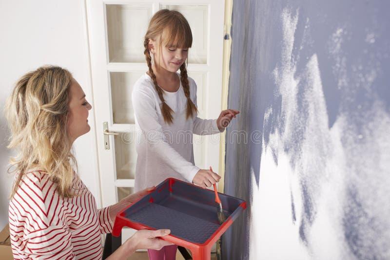 Стена картины матери и дочери стоковые изображения