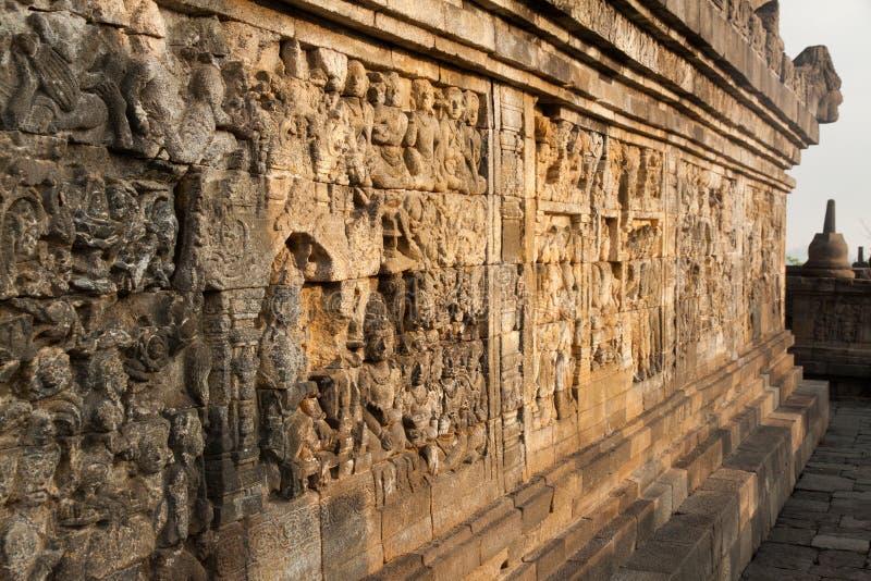 Стена на виске Borobudur в Yogyakarta, Ява, Индонезии стоковые фото