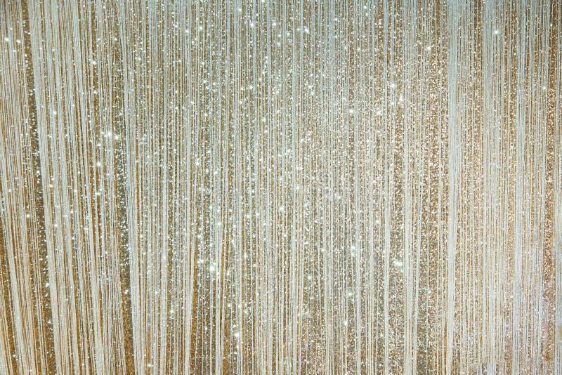 Стена предпосылки яркого блеска искры золота стоковые изображения