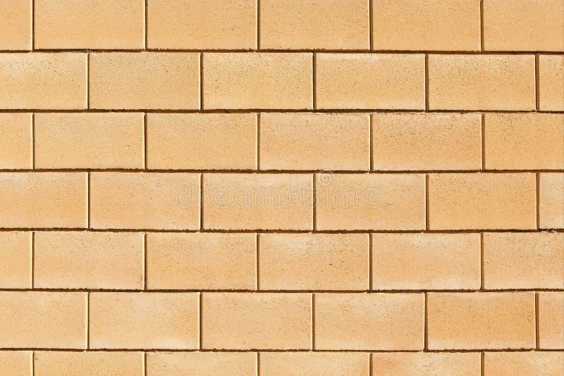 Стена сделанная из ровных, прямоугольных желтых блоков песчаника фоновое изображение, текстура стоковая фотография rf
