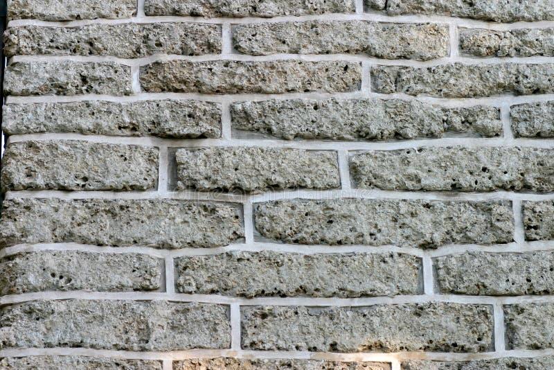 стена серого цвета кирпичей кирпича предпосылки Стоковое Изображение RF