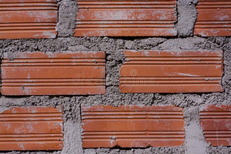 Стена сделанная из кирпичей и цемента стоковая фотография rf