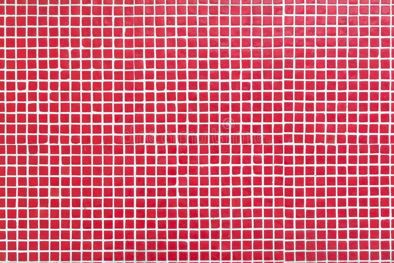 Стена с малыми красными плитками стоковое фото