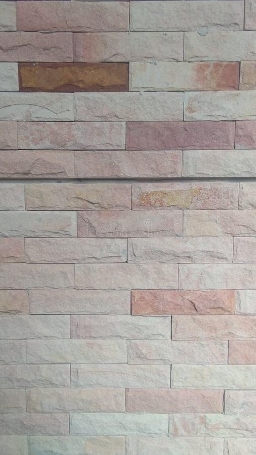 Стена текстуры камня цемента предпосылки кирпича искусства стоковые фото