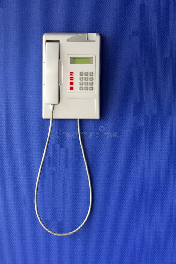 стена телефона предпосылки голубая стоковое фото