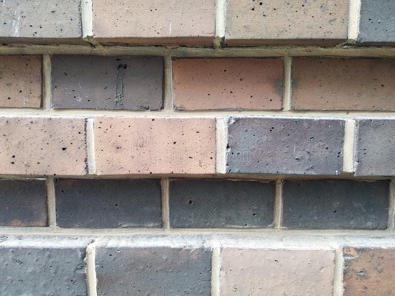 Стена тома красного кирпича ровные и ясные стена или загородка masonry текстура кирпича современная конструкция стоковая фотография rf