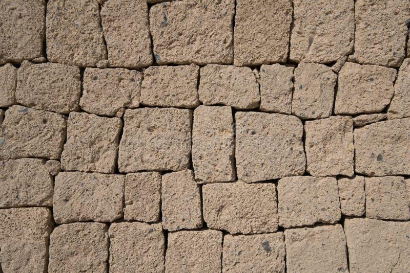 Стена Ignimbrite каменная - естественная предпосылка каменной стены стоковое фото