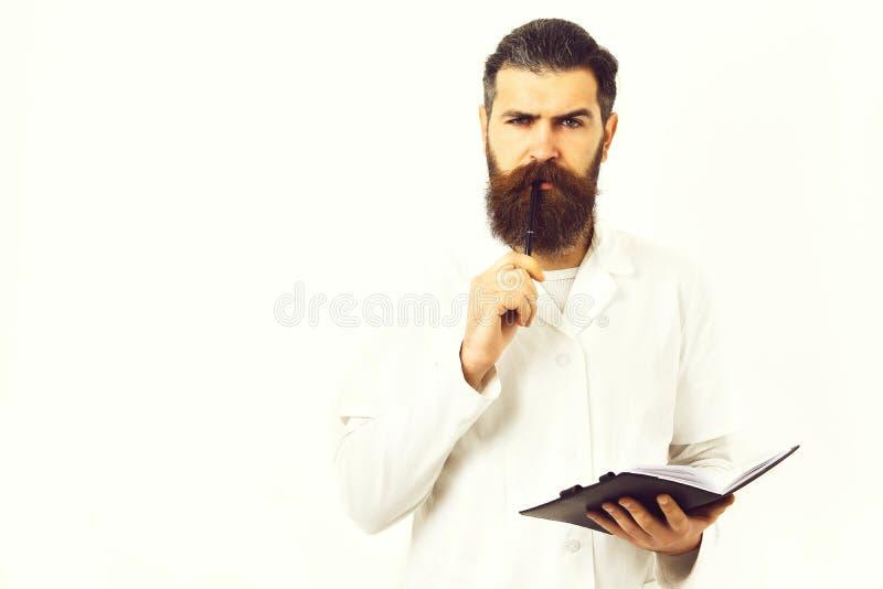 стетоскоп дег микстуры лож принципиальной схемы установленный Бородатый зверский кавказский доктор или аспирантский студент стоковое фото rf