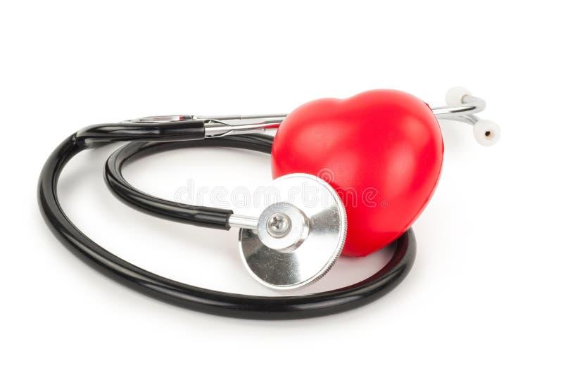 Стетоскоп и сердце стоковые фото