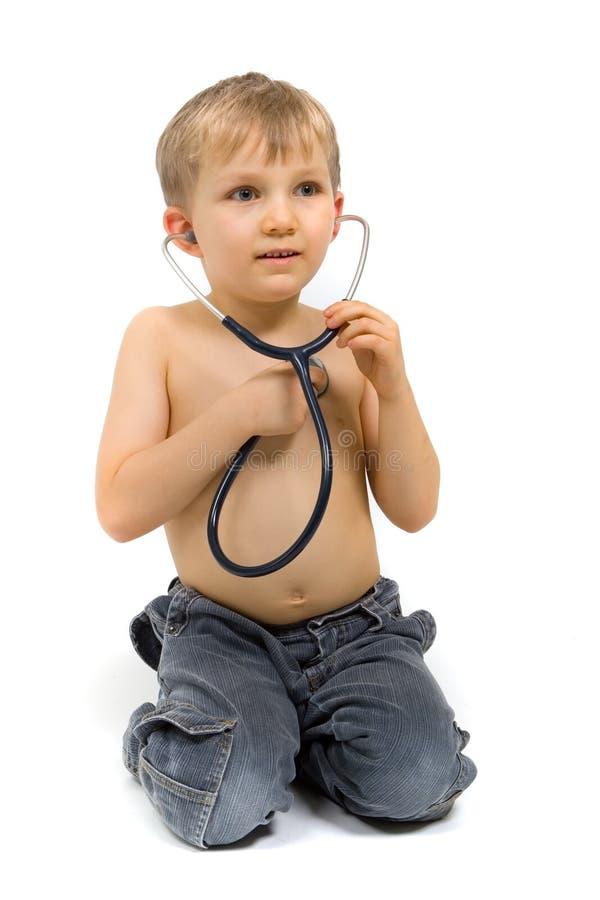 стетоскоп мальчика стоковое изображение rf