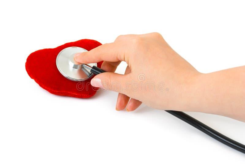 стетоскоп сердца руки стоковая фотография rf