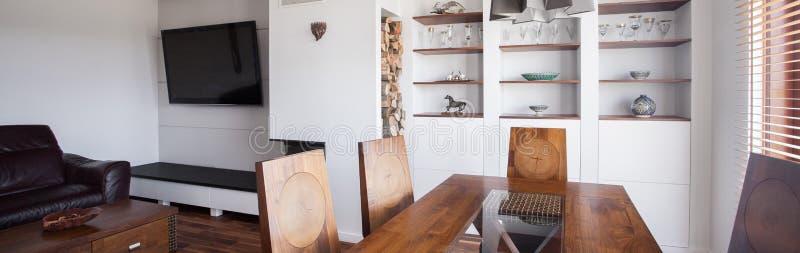 Стильная столовая и салон стоковое фото rf