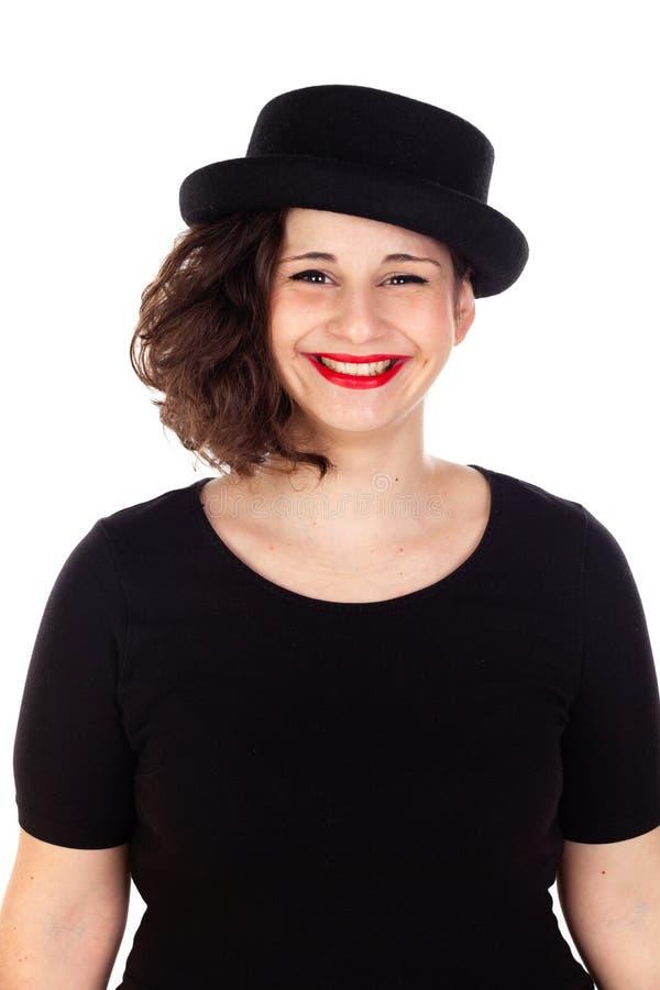 Стильная curvy девушка с черной шляпой и платьем стоковое фото rf