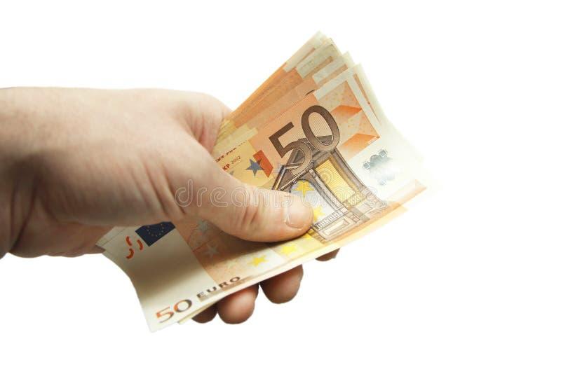 Стог 50 банкнот евро изолированных на белой предпосылке стоковое фото