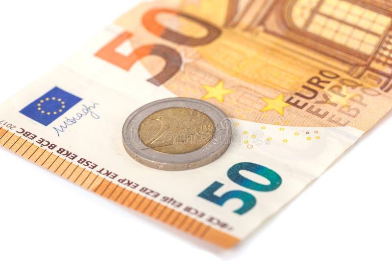 Стог банкнот и монеток евро Banknot евро 50 стоковое изображение