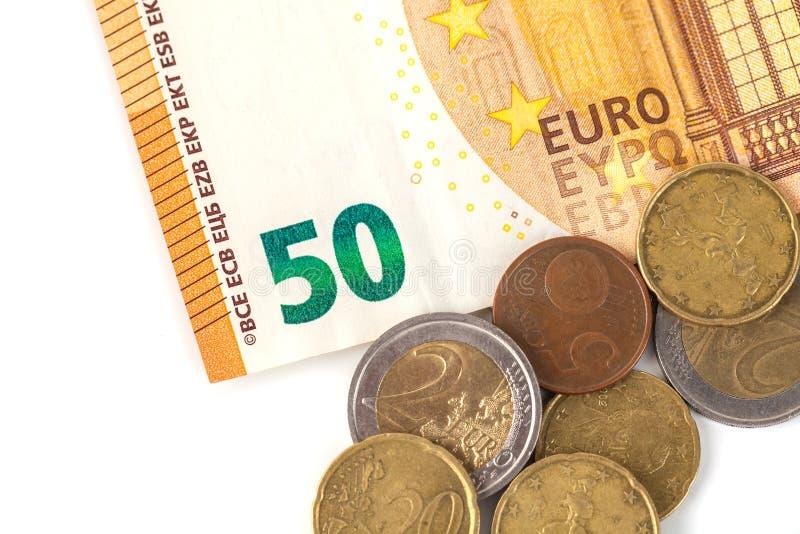 Стог банкнот и монеток евро Banknot евро 50 стоковое фото