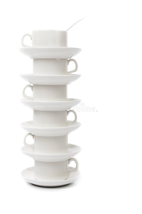 Стог белых кофейных чашек стоковое фото