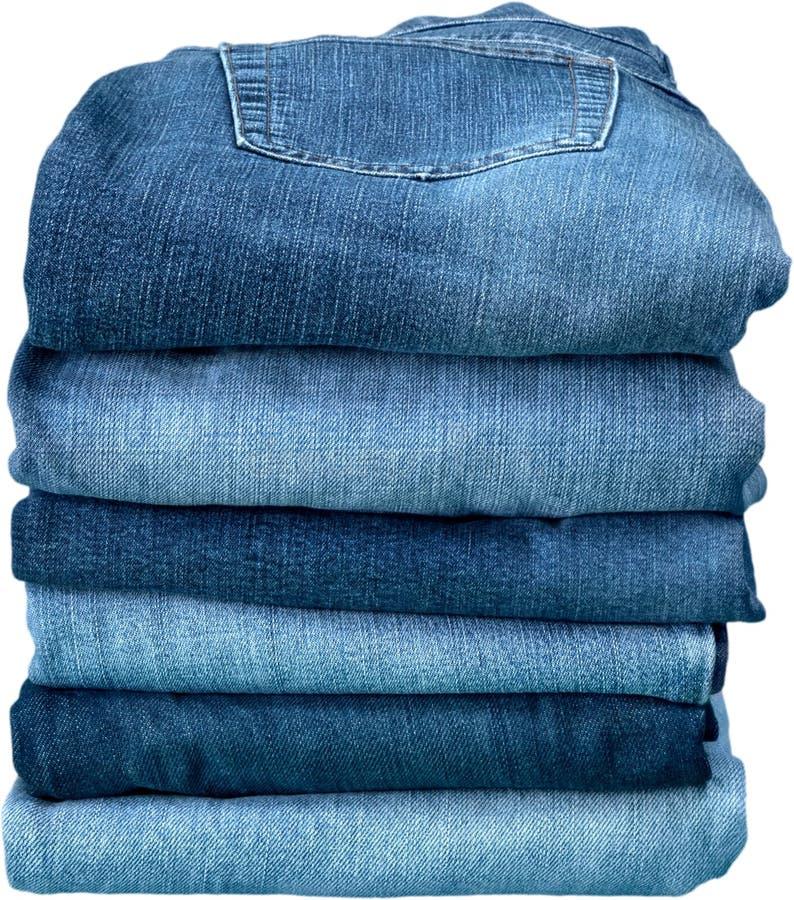Стог джинсов джинсовой ткани изолированных на белизне стоковое изображение rf