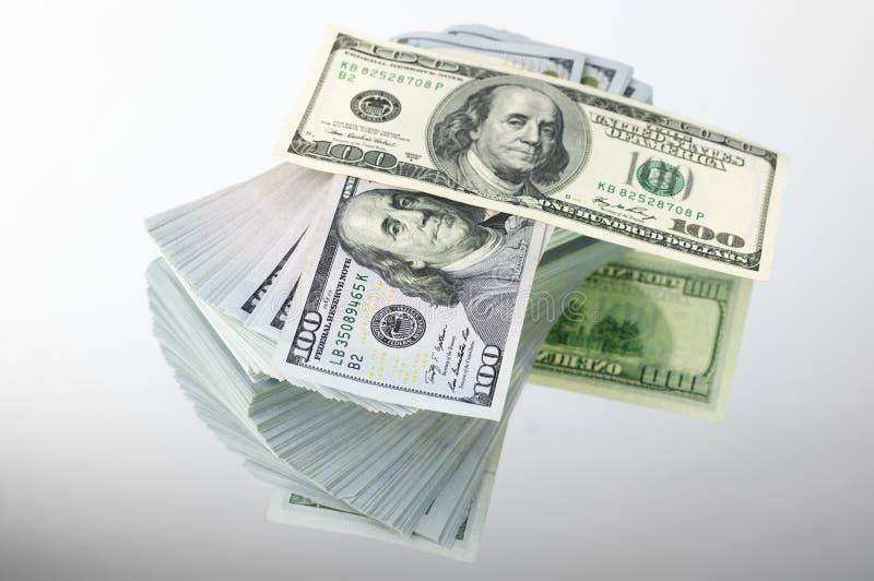 Стог долларовых банкнот стоковое изображение