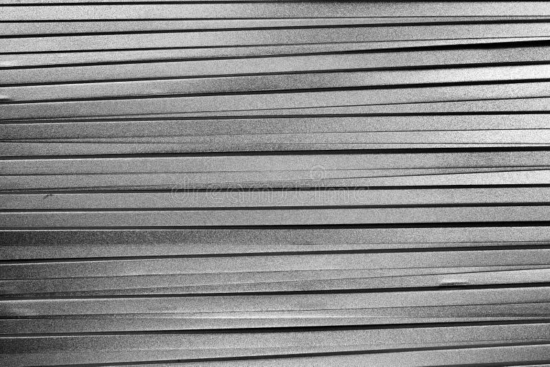 Стог много metal плиты серебра покрашенные как предпосылка стоковое фото