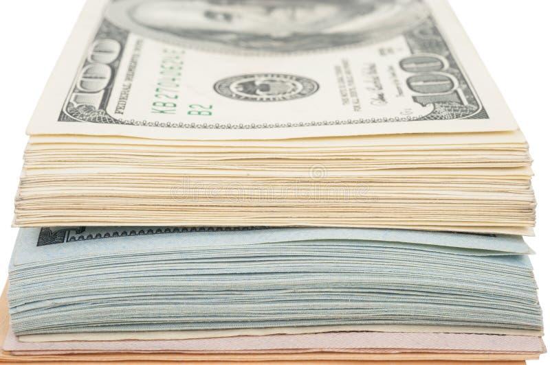 Стог долларовых банкнот американца 100 денег стоковое фото