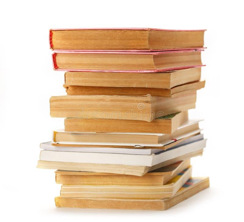 Стог старых книг и кассет стоковая фотография