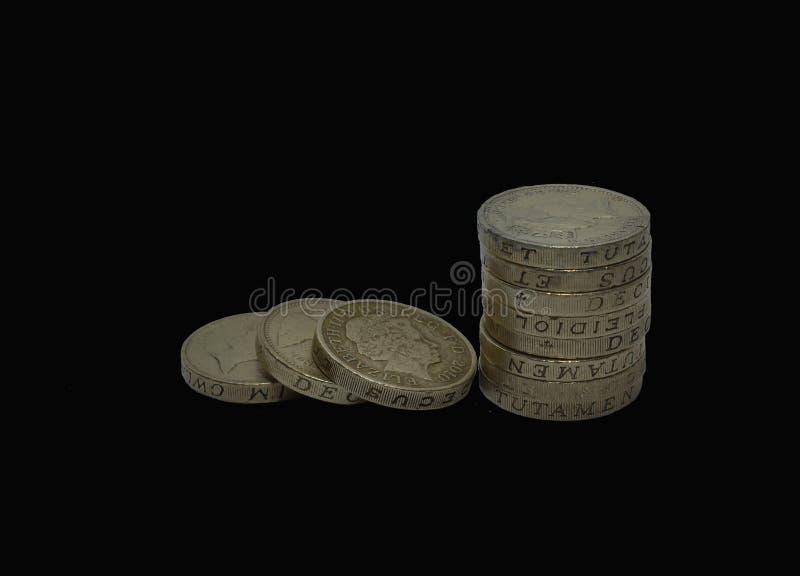 Стог старых монеток фунта стоковое фото rf