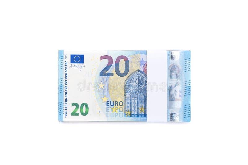 Стог 20 счетов евро изолированных на белой предпосылке для fina стоковые изображения