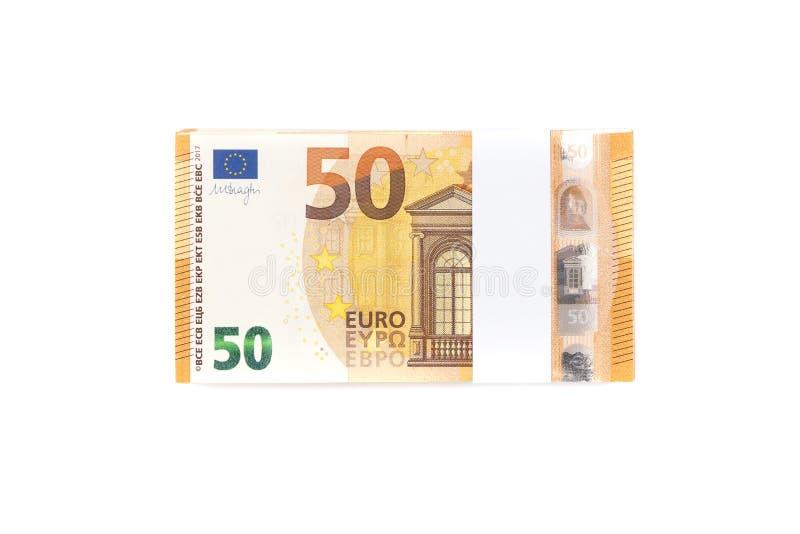 Стог 50 счетов евро изолированных на белой предпосылке для finan стоковое фото
