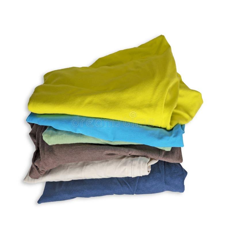 Стог worn пестротканых одежд изолированных на белой предпосылке стоковая фотография rf