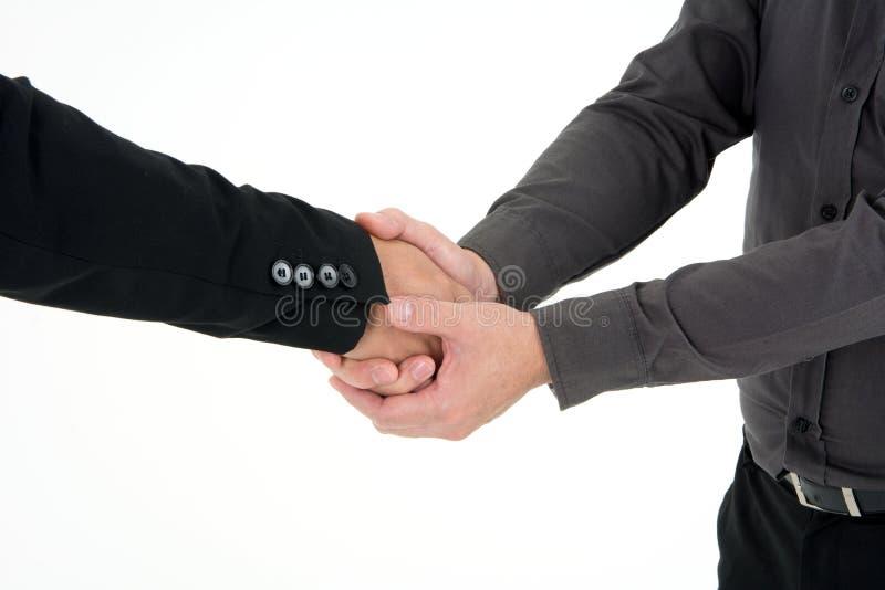Столб 2 бизнесменов для того чтобы трясти руку к и отпраздновать успех изолированную на белой предпосылке стоковые фото