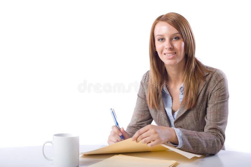 стол дела замечает сочинительство женщины стоковая фотография rf