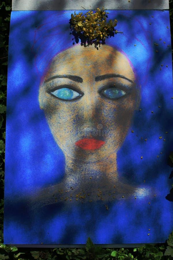 Сторона девушки покрасила с пастелями стоковое изображение rf