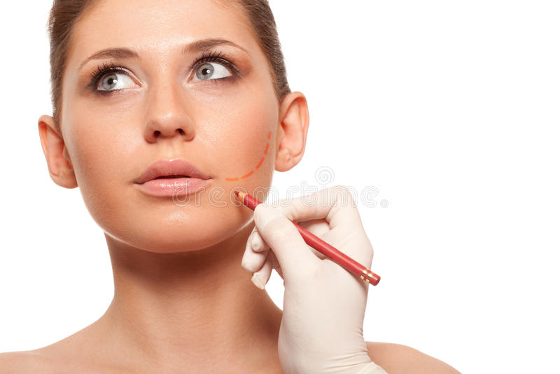 Сторона женщины крупного плана с меткой хирургии стоковое изображение rf