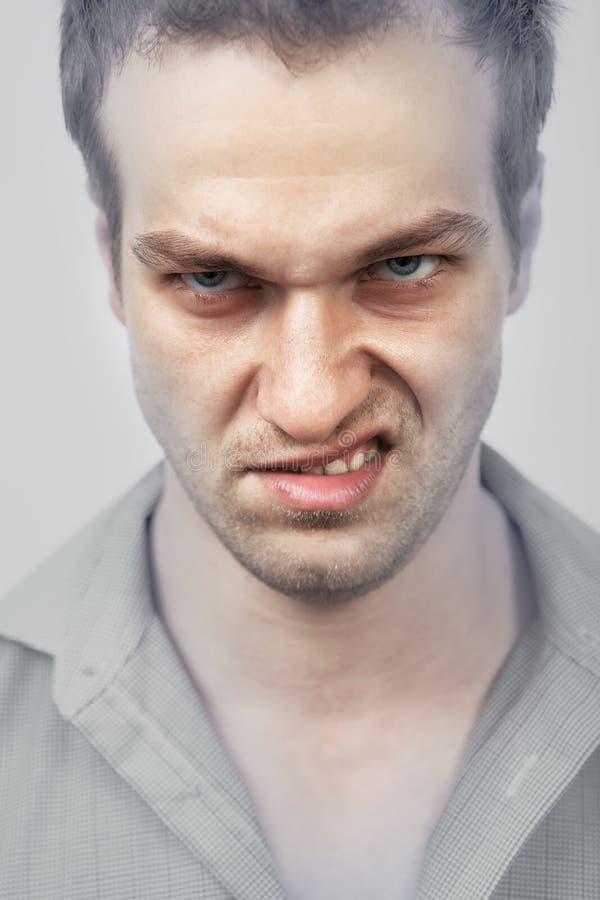 Сторона злого сердитого человека стоковая фотография