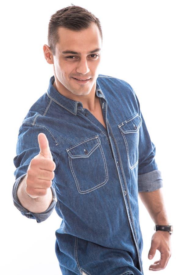 Сторона красивого изолированного человека с большими пальцами руки вверх. стоковые изображения