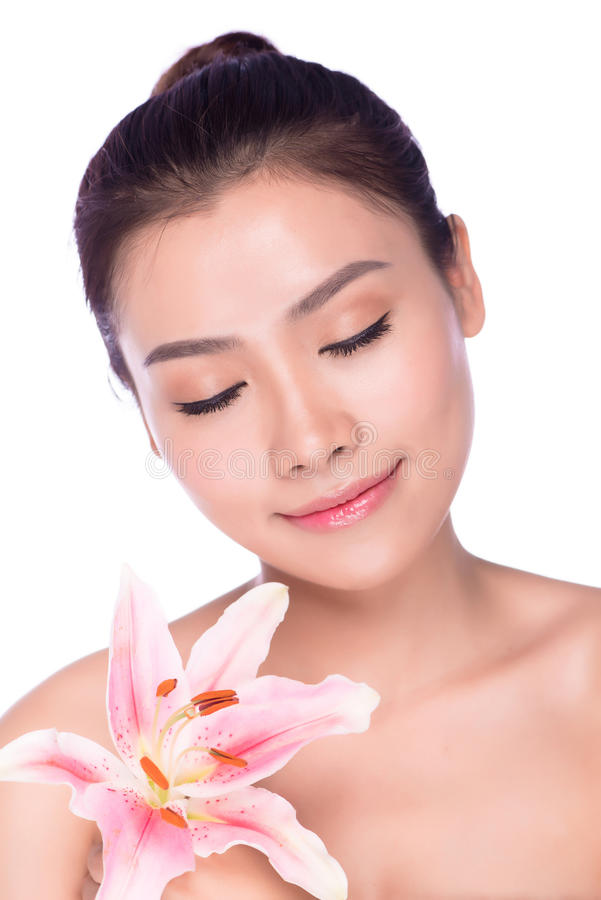 Сторона красотки молодой красивейшей женщины с цветком стоковое изображение