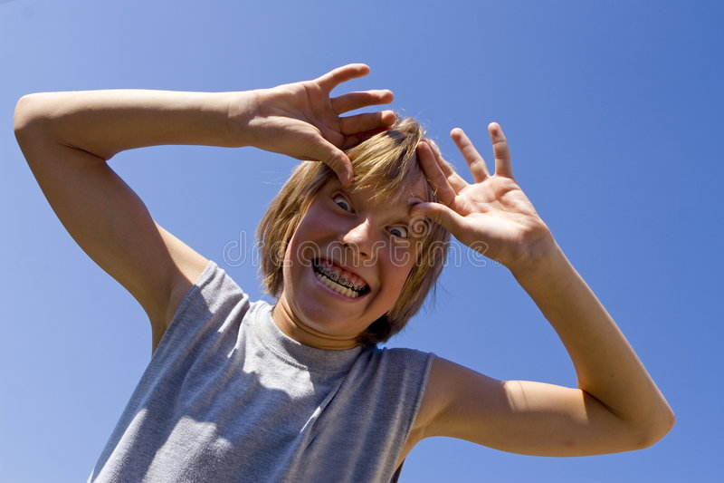 сторона мальчика придурковатая стоковое изображение