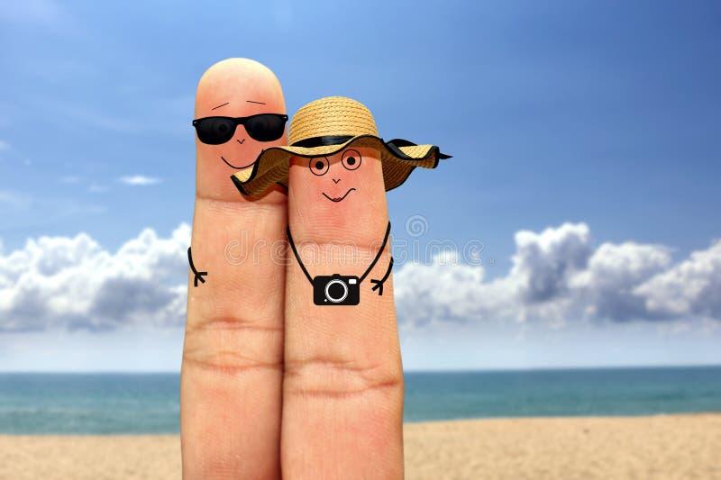 Сторона пар пальца на каникулах на пляже стоковое фото rf