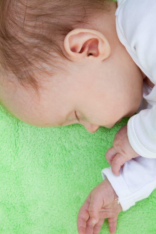 Сторона спать младенца стоковая фотография