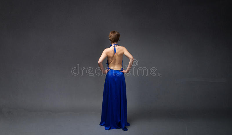 Сторона элегантной девушки задняя стоковые изображения