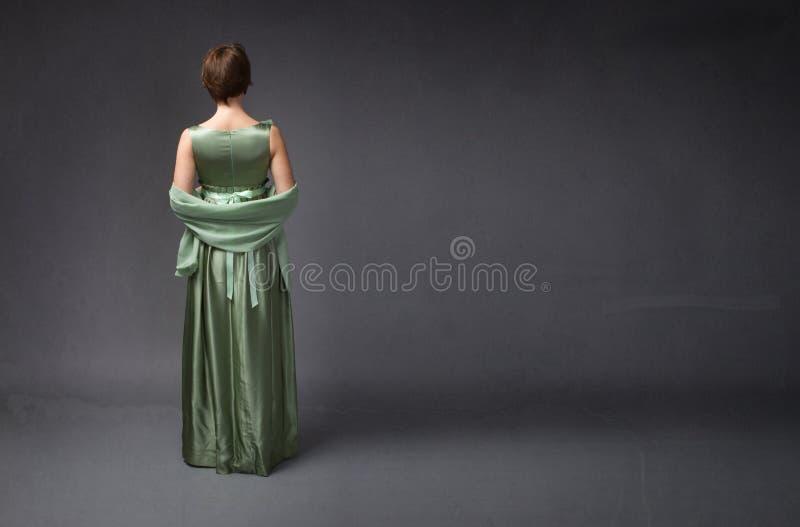 Сторона элегантной женщины задняя стоковые изображения rf