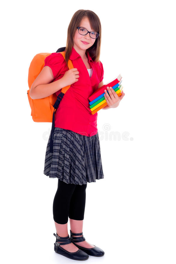 Стоящая школьница держа книги стоковое изображение