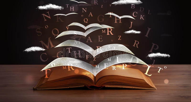 Страницы и накаляя письма летая из книги стоковая фотография rf