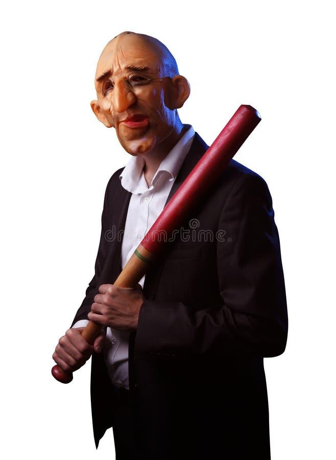 Страшный человек в костюме с маской и бейсбольной битой стоковое фото