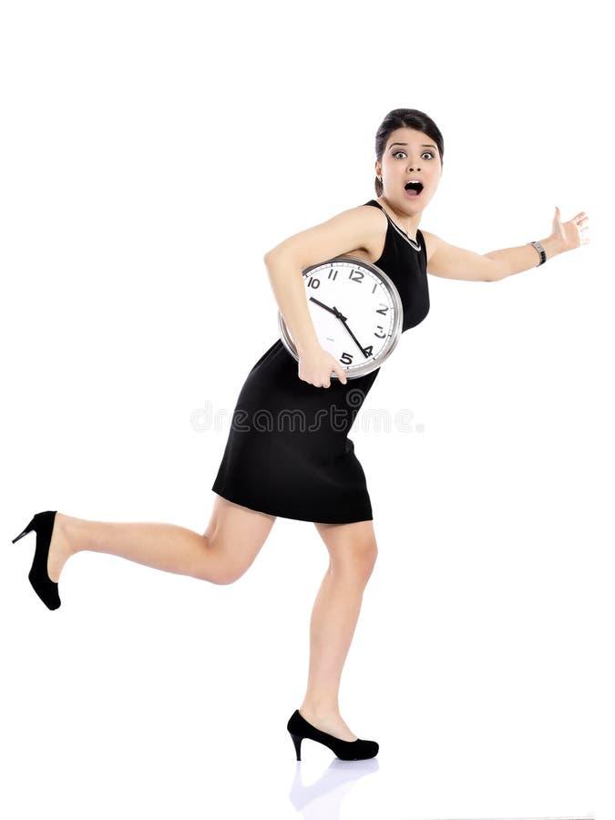 Стресс - бизнес-леди бежать поздно стоковые изображения